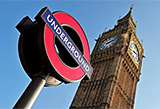 London Underground sign at Westminster with Big Ben in the background